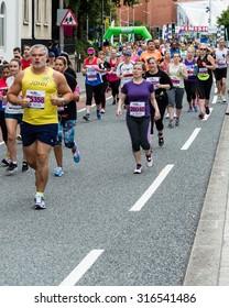 Bristol, England - 13 SEPTEMBER 2015 Bristol Half Marathon 2015 - runner 26040 and others (unidentified runners)