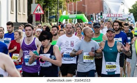 Bristol, England - 13 SEPTEMBER 2015 Bristol Half Marathon 2015 - runners 14955, 14499 and others (unidentified runners)