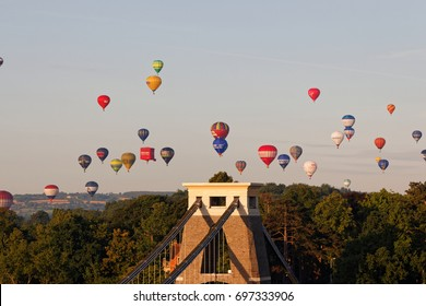 Bristol, England - August 13, 2017: Clifton Suspension Bridge,Bristol International Balloon Fiesta is Europe's largest annual meeting of hot air balloons. Morning mass hot air balloon lift.