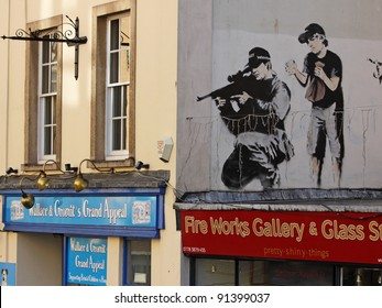 BRISTOL, ENGLAND - FEBRUARY 26: Police sniper by Banksy in Upper Maudlin Street in Bristol, England on February 26, 2011. The image has since been over-painted, allegedly by a rival artist