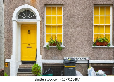 Bristol, England - February 28, 2019 - A Georgian style house frontage decorated with yellow colour and pebbledash wall