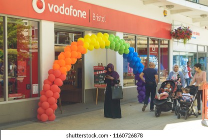 Bristol, England - July 14, 2018: Muslima Standing under Rainbow Balloons Arch outside Vodafone Shop, Diversity in Britain, Shallow Depth of Field
