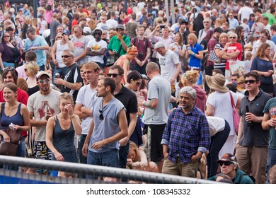 BRISTOL, ENGLAND - JULY 21: Audience at the Queen Square stage at the Harbour Festival in Bristol, England on July 21, 2012. Founded in 1972, the three day festival attracted around 300,000 spectators