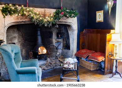 Bristol, England - March 11th 2013: Afternoon tea by the fireside in a country house