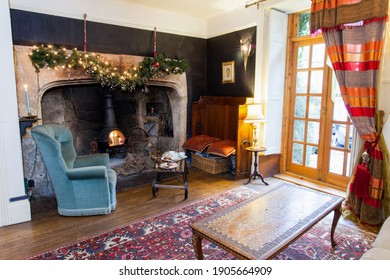 Bristol, England- March 11th 2013: Afternoon tea by the fireside in a country house