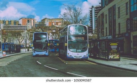 Bristol, England - March 16, 2018: First Group Buses in City Centre, Split Toning Shallow Depth of Field Horizontal Photography