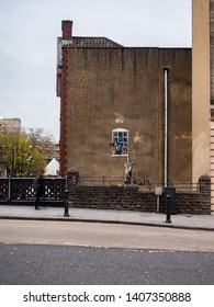 Bristol, England - March 21, 2019: View from across the street of one of Banksy's artwork, Well Hung Lover.