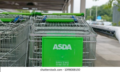 Bristol, England - May 24, 2018: Close up of ASDA shopping trolley - logo view, shallow depth of field