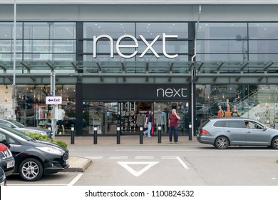 Bristol, England - May 28, 2018: Entrance to Next Store B, Bristol Imperial Park, modern architecture shallow depth of field