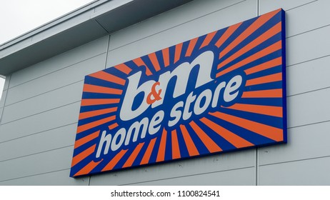 Bristol, England - May 28, 2018: B&M Home Store shop logo, modern architecture shallow depth of field