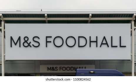 Bristol, England - May 28, 2018: M&S Foodhall shop logo, Marks and Spencer, modern architecture shallow depth of field