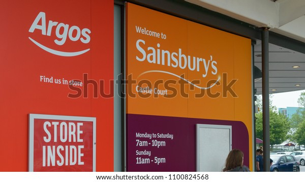 Bristol, England - May 28, 2018: Logos of Argos and Sainsbury's Castle Court, shallow depth of field