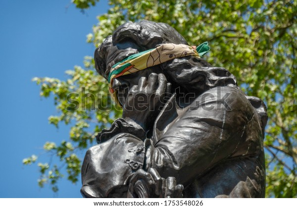 Bristol / England - May 6th 2020: Statue of Edward Colston with blindfold before it was taken down by protestors