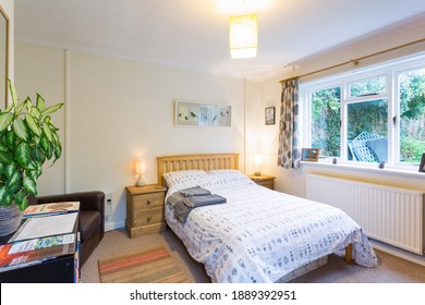 Bristol, England - October 12th 2018: A well presented and bright bedroom