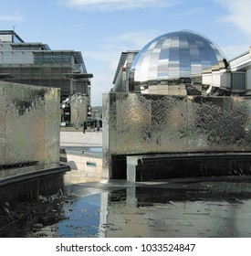 Bristol England UK October 21st, 2017:Bristol millennium square showing steel waterfall and reflective sphere with blue sky