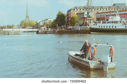 Bristol Harbour Master, View of boat with Prince Street Bridge and St Mary Redcliffe Tower Church in background, Shallow Depth of Field Split Toning Photography