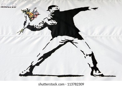 BRISTOL - MARCH 24: A Banksy graffiti piece promotes an art show at Elim Church on March 24, 2011 in Bristol, UK. Bristol is internationally renowned for it's vibrant cultural and street art scene.