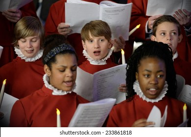 BRISTOL - NOV 7: Bristol Cathedral Choir perform in Cabot Circus shopping mall on Nov 7, 2014 in Bristol, UK. The choir peformed traditional Christmas carols for visitors to the mall.