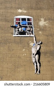 "BRISTOL - NOV 8: View of a graffiti piece named ""Naked Man"" by street artist Banksy on a city centre wall on Nov 8, 2010 in Bristol, UK. Banksy is an internationally acclaimed artist from Bristol."
