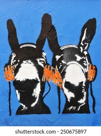 BRISTOL - NOV 8: View of a graffiti piece of donkeys with headphones by an unidentified artist on a city centre wall on Nov 8, 2010 in Bristol, UK. Bristol is famed for its graffiti and street art.