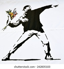 BRISTOL - OCT 19: Print of a famous Banksy graffiti piece promoting an art show at Elim Church on Oct 19, 2010 in Bristol, UK. Bristol is renowned for it's vibrant and political street art scene.