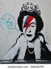 BRISTOL - OCT 31: View of a Banksy piece depicting the Queen as Ziggy Stardust seen on a city centre street on Oct 31, 2015 in Bristol, UK. Banksy is a world renowned street artist from Bristol.