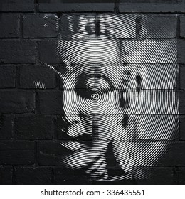 BRISTOL - OCT 31: View of a Buddha inspired stencil graffiti piece on a city centre wall on Oct 31, 2015 in Bristol, UK. The west country city is famous for its street art and graffiti.