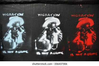 BRISTOL - OCT 31: View of Paddington Bear migration themed graffiti by street artist Banksy on a city centre wall on Oct 31, 2015 in Bristol, UK. Immigration policy is a reoccurring topic in the UK.