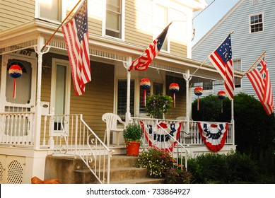 Bristol, RI, USA July 3, 2009 A house in Bristol, Rhode Island flies the stars and stripes on Independence Day.  Bristol is said to host the oldest continuous Fourth of July parade in America/