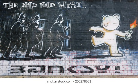 BRISTOL - SEP 26: View of a Banksy graffiti piece titled Mild Mild West on a brick wall in the city centre on Sep 26, 2010 in Bristol, UK. Bristol is famous for its political street art scene.
