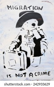 BRISTOL - SEP 26: View of Paddington Bear migration themed graffiti by street artist Banksy on a city centre wall on Sep 26, 2010 in Bristol, UK. Immigration policy is a reoccurring topic in the UK.