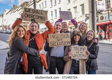 Bristol, UK - 04 February 2017:  Group of young women wave banners and march through the city of Bristol, UK, protesting against the policies of Donald Trump, and his proposed state visit to the UK.