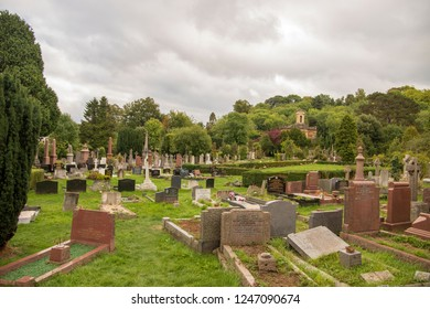 Bristol, UK, 09-17-2018: Walking through the graves and graveyard of Arnos Court Cemetery, Bristol, UK