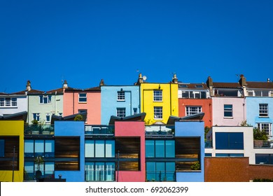 Bristol, UK - 2 July 2017: Colour image showing colourful residential homes located on Bristol harbourside, set against a cloudless, blue sky in the summer.