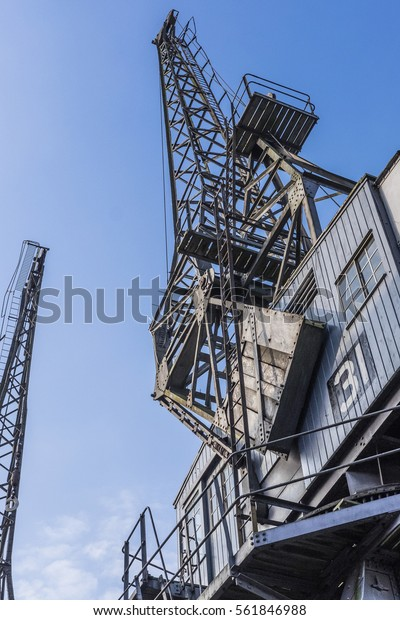 Bristol, UK - 22 January 2017:  Colour image looking up at one of the iconic cranes located outside the M-Shed museum as part of the post-industrial harbour area of Bristol