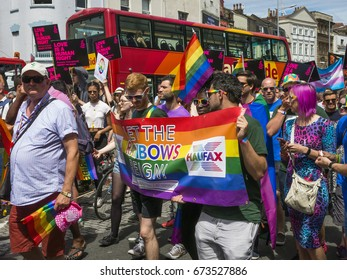 Bristol, UK - 8 July 2017: People carry colourful rainbow flags and banners to celebrate  Pride 2017 on the streets of Bristol, UK.
