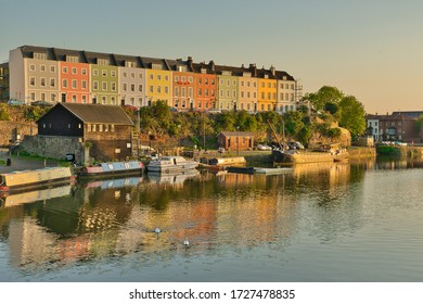 Bristol, UK - 8th May, 2020: Array of colourful houses alongside Bristol's floating harbour