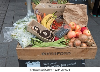 BRISTOL, UK - APRIL 28, 2017: A box of fruit and vegetables from Riverford Organic Farmers on display in a street market.