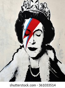 BRISTOL, UK - AUG 21, 2015: View of a Bansky piece depicting David Bowie's Ziggy Stardust persona as the Queen seen on a city centre street. Banksy is a world renowned street artist from Bristol.