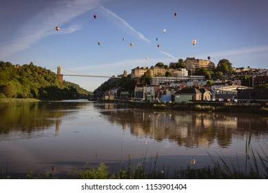 Bristol, UK - August 11, 2018: View of the suspension bridge and launching balloons at 40th Anniversary of the International Balloon Fiesta; hundred of balloons launching at dawn.