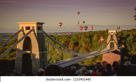 Bristol, UK - August 11, 2018: Tourists flock to Bristol UK to witness the 40th Anniversary of the International Balloon Fiesta; hundred of balloons launching at dawn.