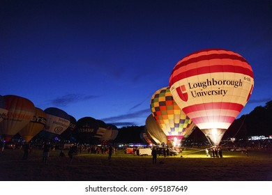 Bristol, UK: August 13, 2016: Night Glow at the Bristol International Balloon Fiesta. The annual event has become Europe's largest hot air balloon festival. The Loughborough University balloon.