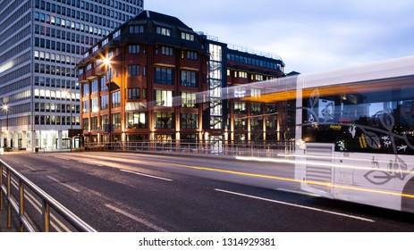 BRISTOL, UK - FEBRUARY 16, 2019: Bristol Bridge Bus with light trails at dawn