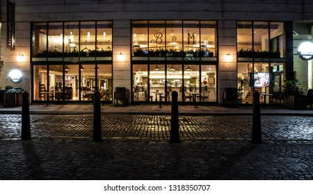 BRISTOL, UK - FEBRUARY 16, 2019: Buttermilk & Maple, Bar and Restaurant by night at the Mecure Hotel, Bristol, UK