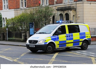 Bristol, UK - February 24, 2011: A police Vehicle responds to an emergency on a city centre street.