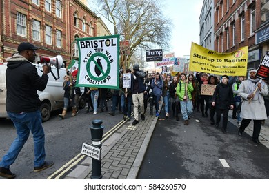 Bristol, UK - February 4, 2017: Protesters march through the city centre demonstrating against US President Donald Trump's UK visit and his order banning travel to the USA from seven Muslim countries.