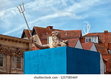 BRISTOL, UK - JULY 5, 2016: A statue of Neptune surrounded by hoardings to protect it during work on the city's new Metrobus system. The statue, which dates from 1723, is a grade II* listed structure.
