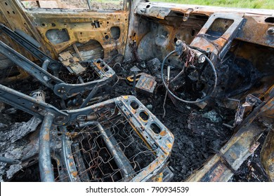 Bristol, UK - June 1st 2017: A burnt out car lies abandoned on wasteland