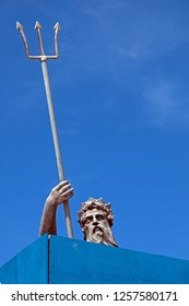 BRISTOL, UK - JUNE 2, 2016: A statue of Neptune surrounded by hoardings to protect it during work on the city's new Metrobus system. The statue, which dates from 1723, is a grade II* listed structure.