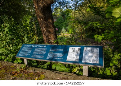 Bristol, UK - June 29th 2019: An information sign at the historic Quakers Burial Ground in the city of Bristol in England.